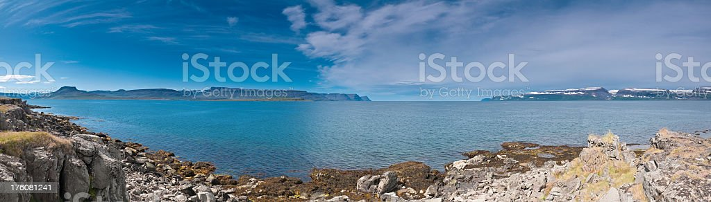 Blue fjord ocean shore mountain wilderness panorama Iceland royalty-free stock photo