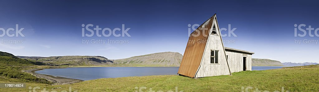 Blue fjords green pasture Nordic chalet panorama Iceland royalty-free stock photo