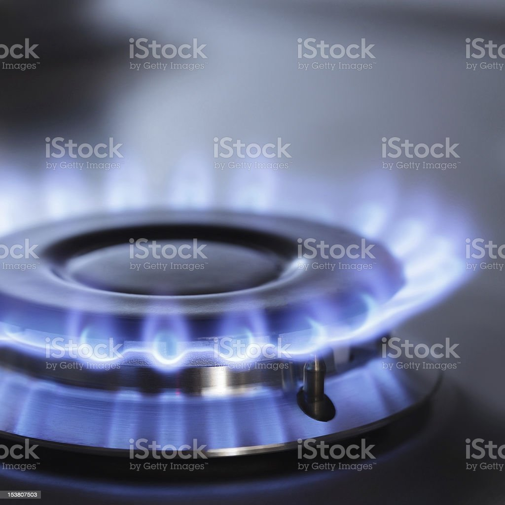 Blue flame from a gas ring on a stove stock photo