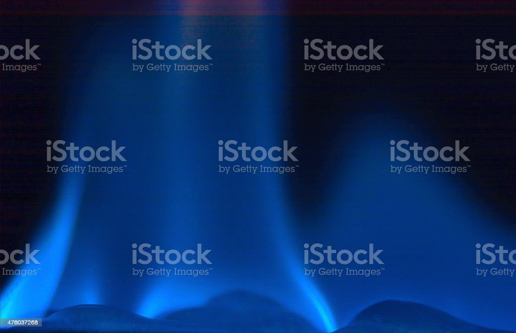 Blue flame on a black background with copy space. stock photo