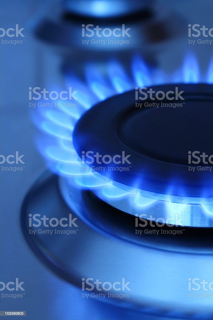 Blue flames coming from natural gas stock photo