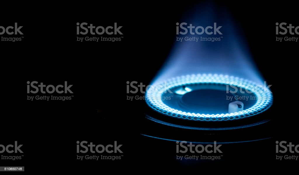 Blue flames from burner - Stock Image stock photo