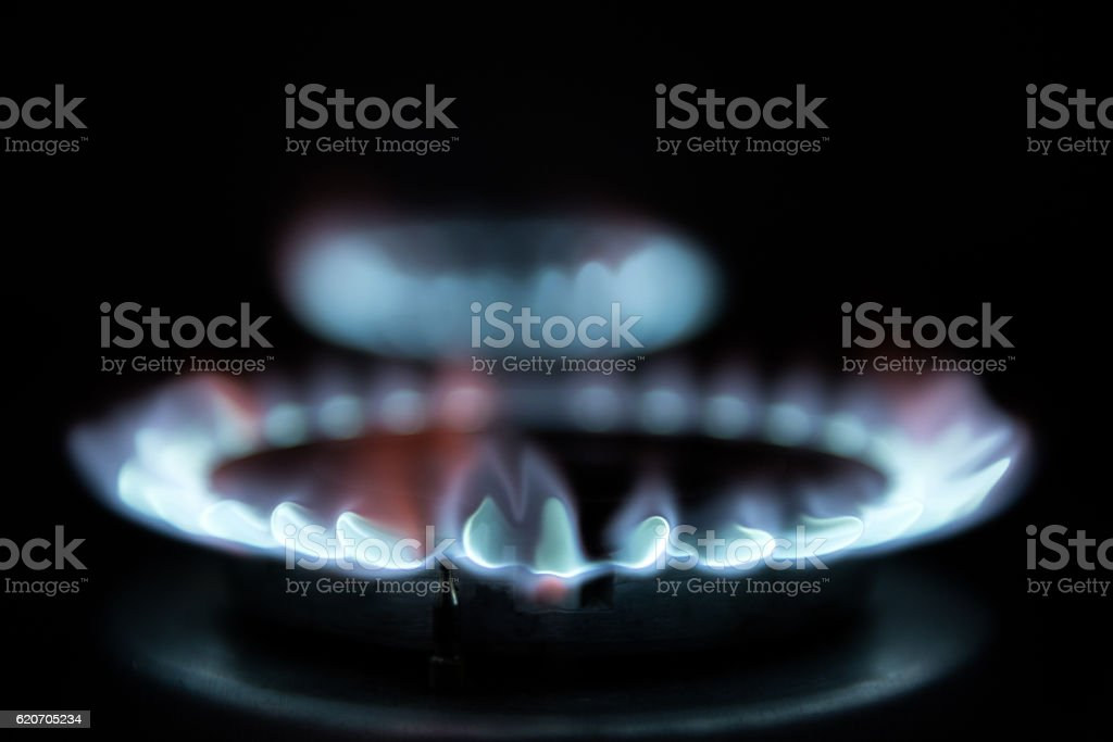 Blue flames from natural gas stock photo