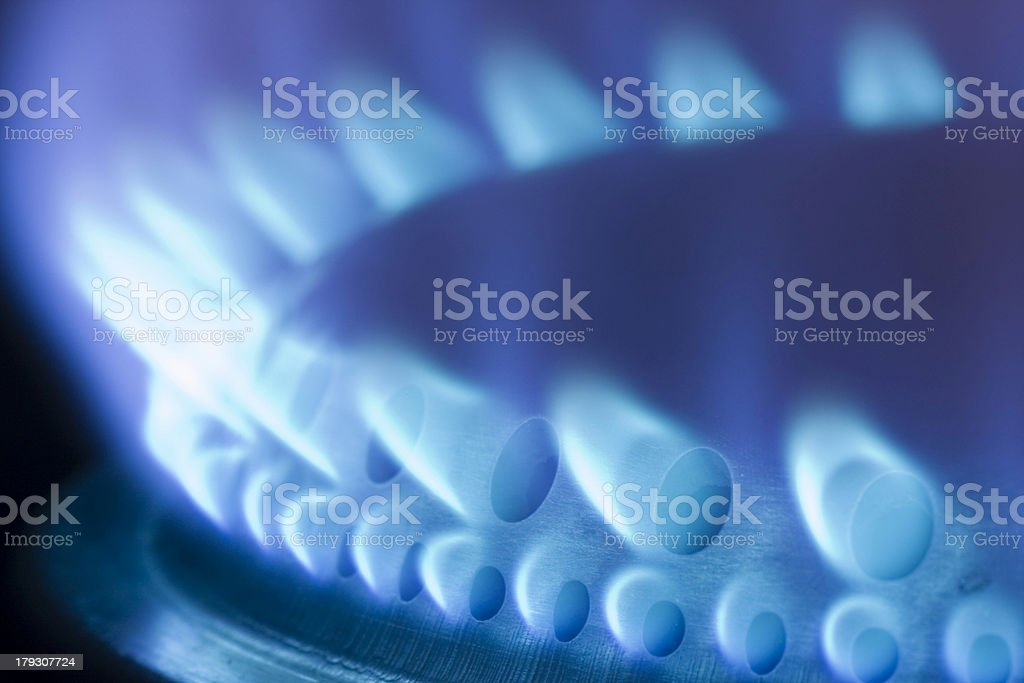 Blue flames of a gas stove stock photo