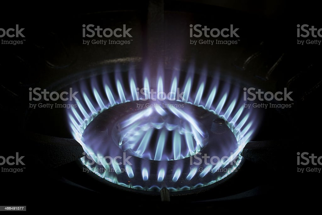Blue flames of gas burning stock photo