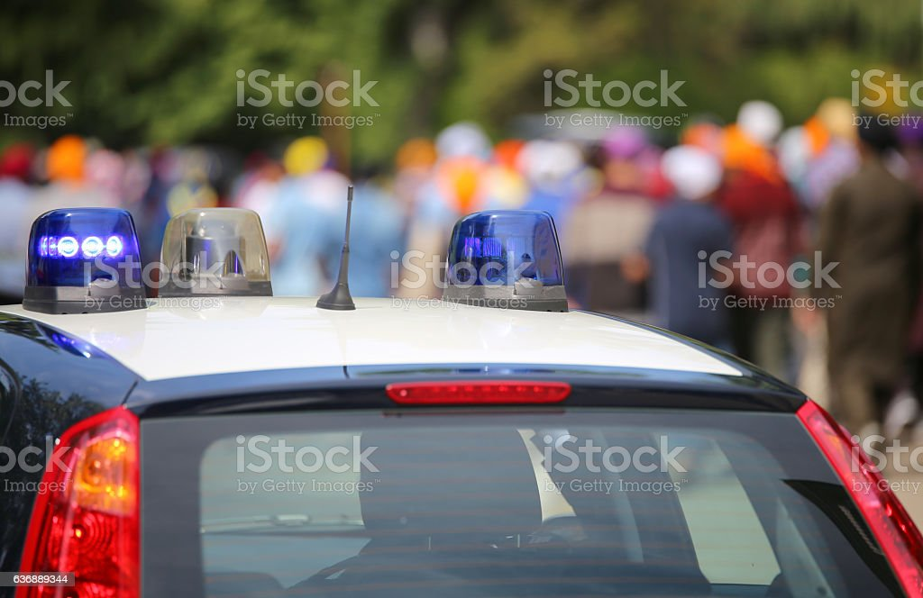blue flashing lights of the police car stock photo