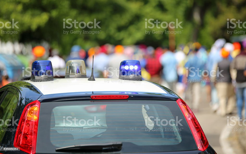 blue flashing lights of the police car to patrol stock photo