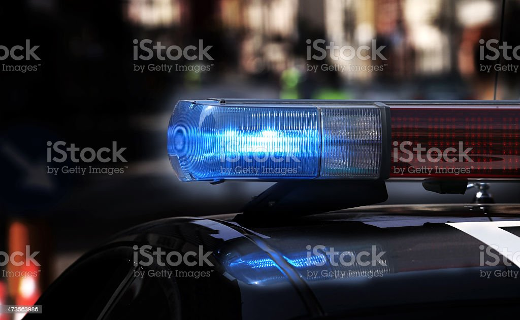 Blue flashing sirens of police car stock photo