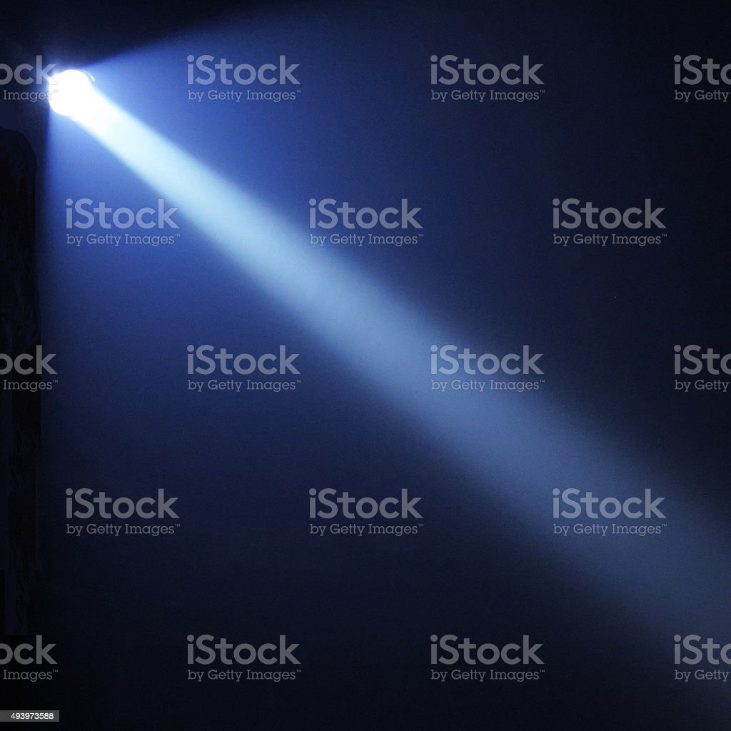 Blue Flashlight Beam at Night stock photo
