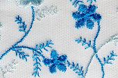 Blue floral lace paternon white texture