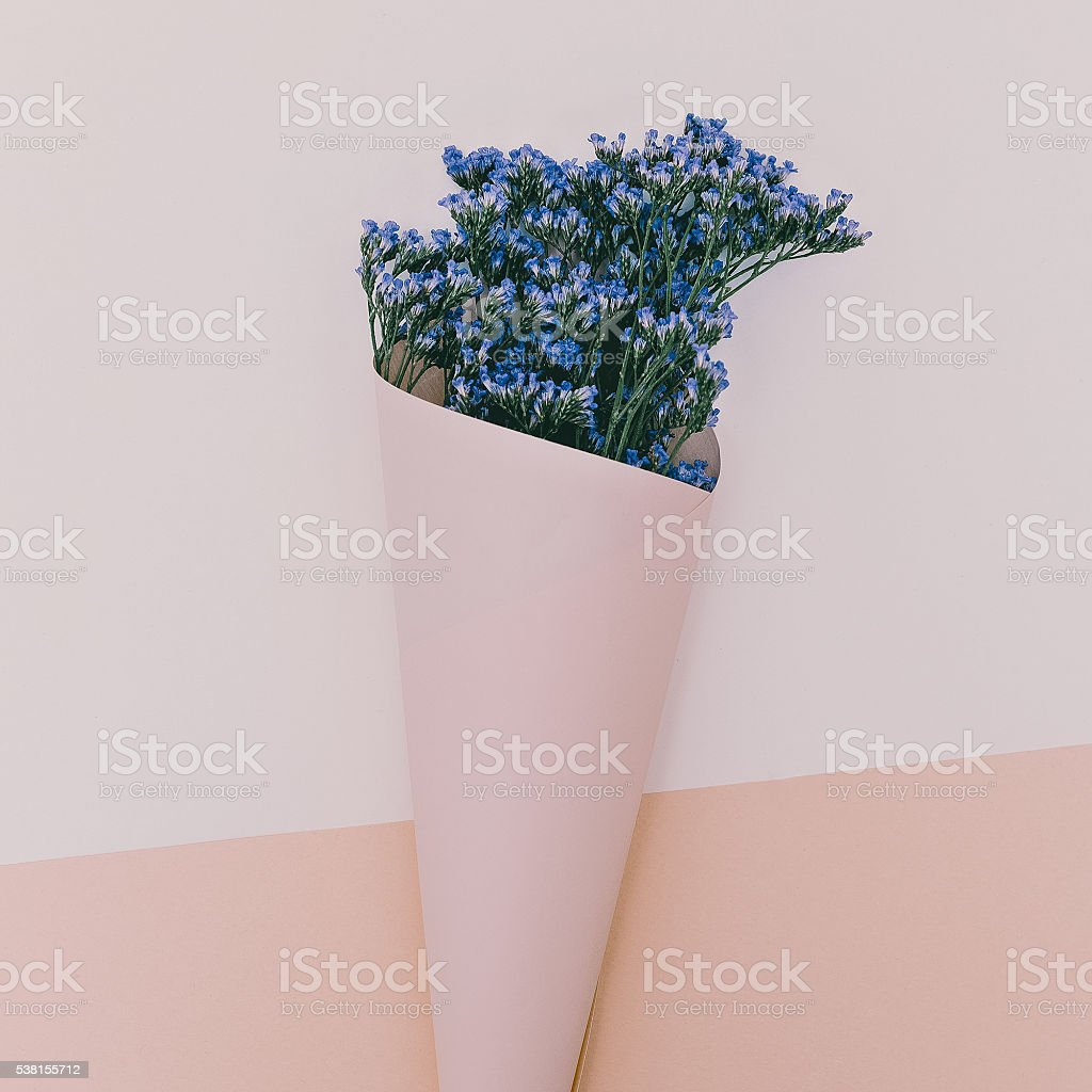 Blue flowers in envelope. Aroma of Spring. Minimalism style stock photo