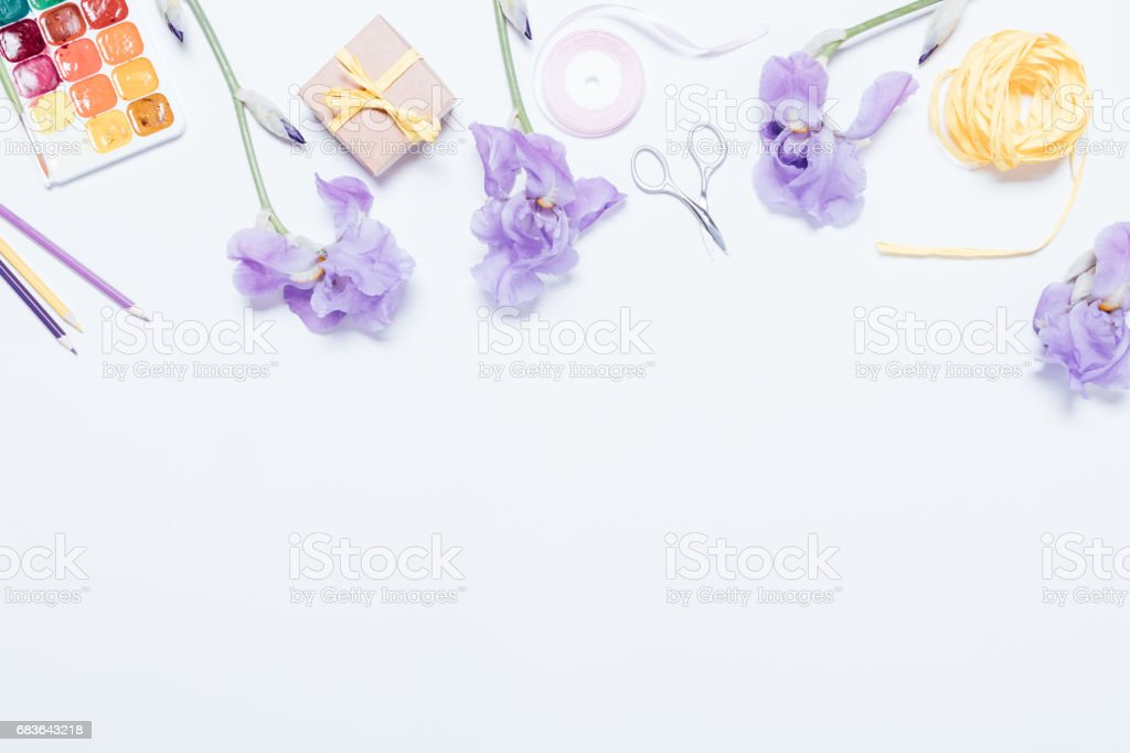 Blue flowers, watercolor paints, boxes with gift and ribbons on white background stock photo