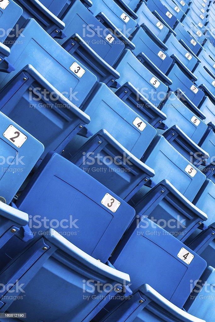 Blue folded seats in a stadium stock photo