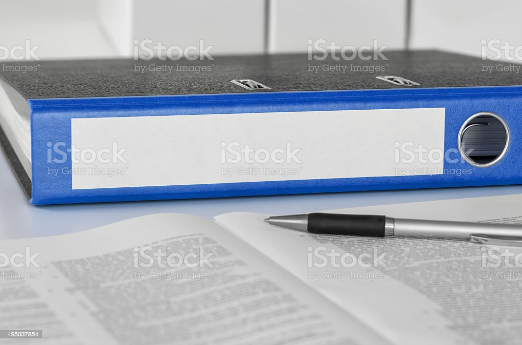 Blue folder with an empty label stock photo