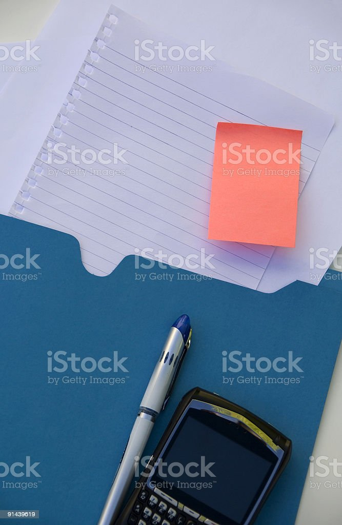 Blue Folder with Blank Paper and PDA royalty-free stock photo