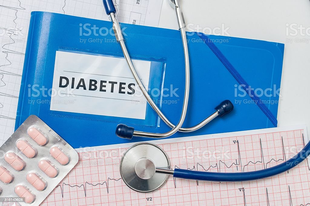 Blue folder with Diabetes diagnosis and stethoscope. stock photo