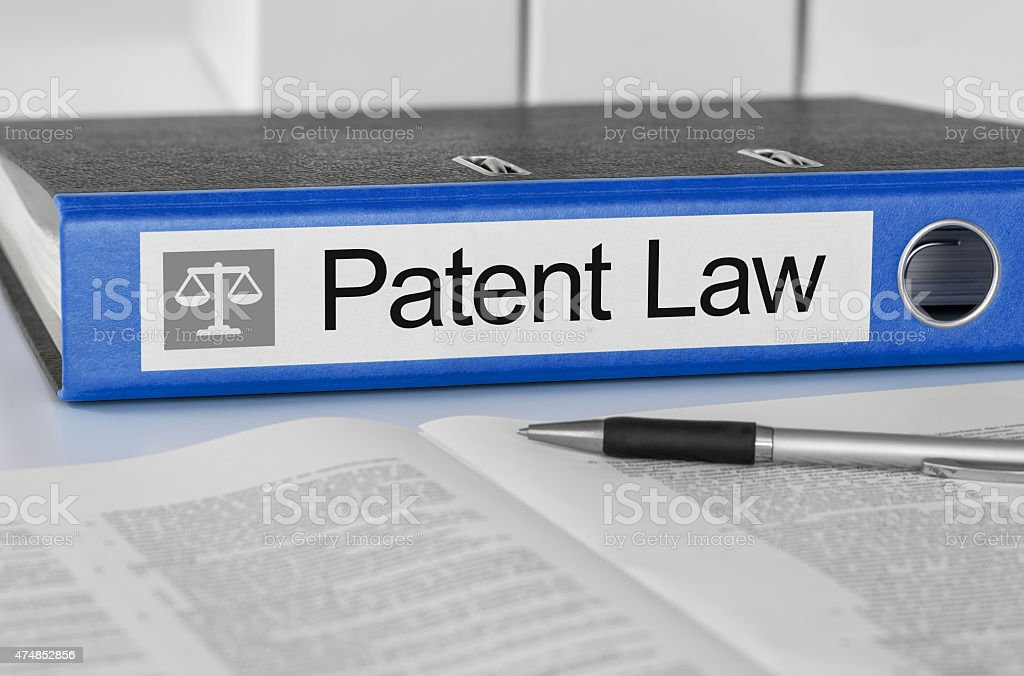 Blue folder with the label Patent Law stock photo