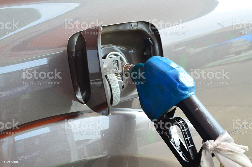 Blue Fuel Nozzle Filling In Vehicle stock photo