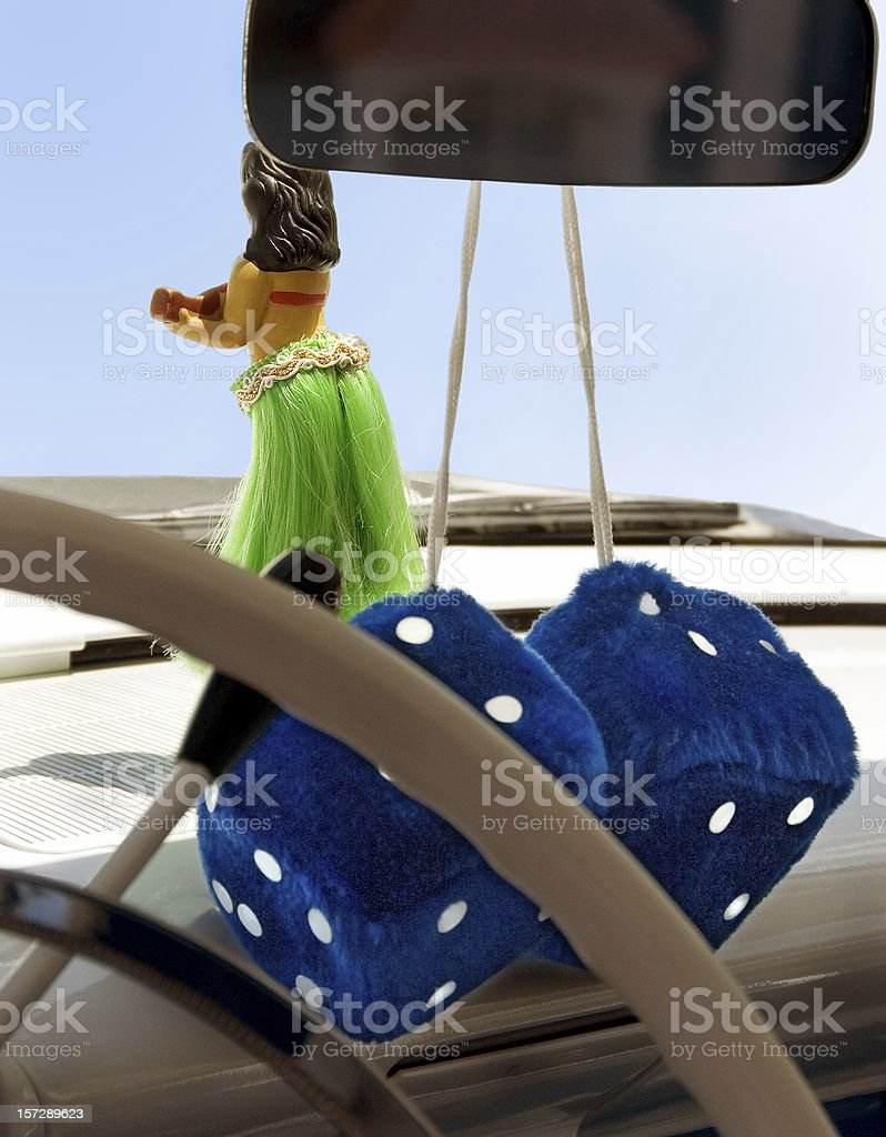 Blue Fuzzy Dice with Dashboard Hula Dancer Ornament stock photo
