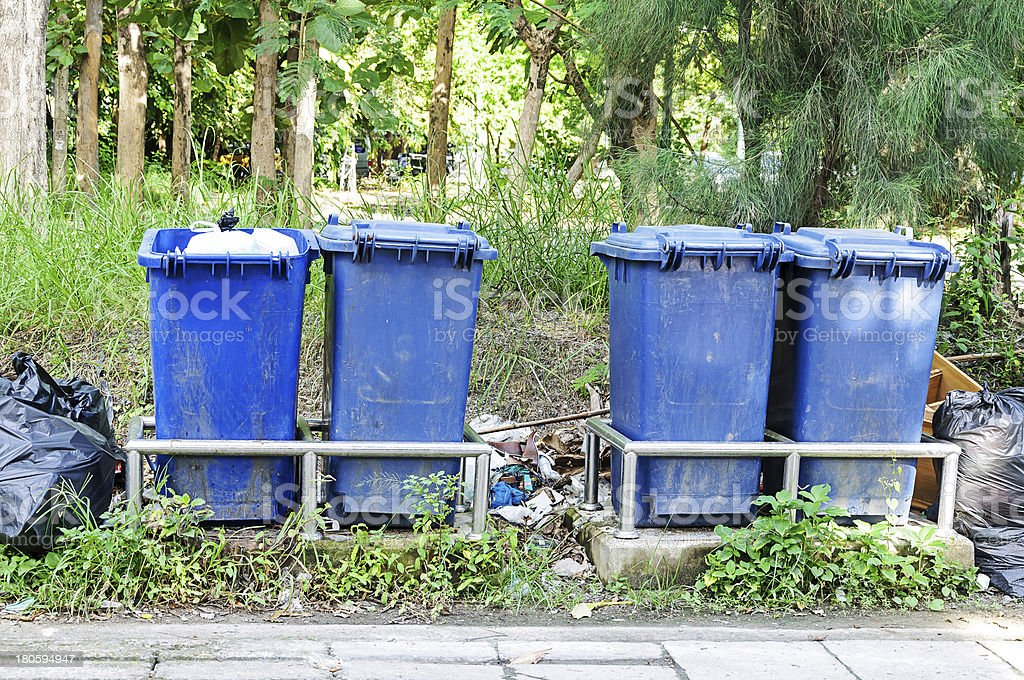 Blue garbage cans royalty-free stock photo