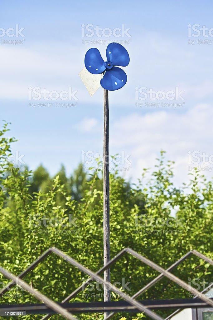 Blue Garden Windmill stock photo