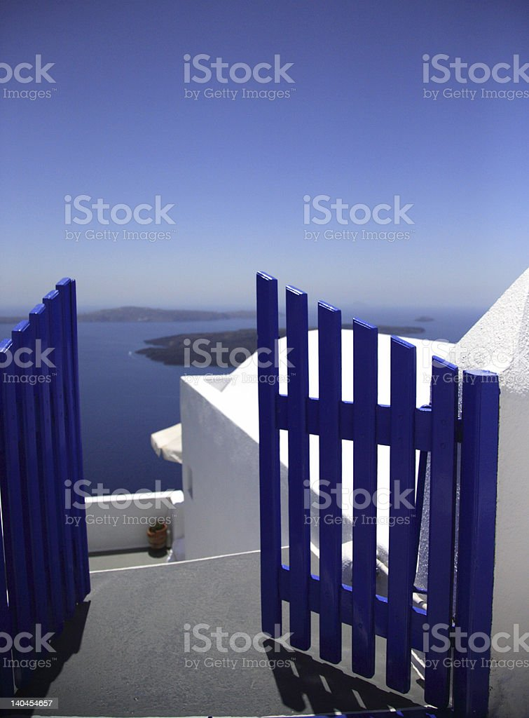 Blue gate, while walls, blue sky, Santorini Greece royalty-free stock photo