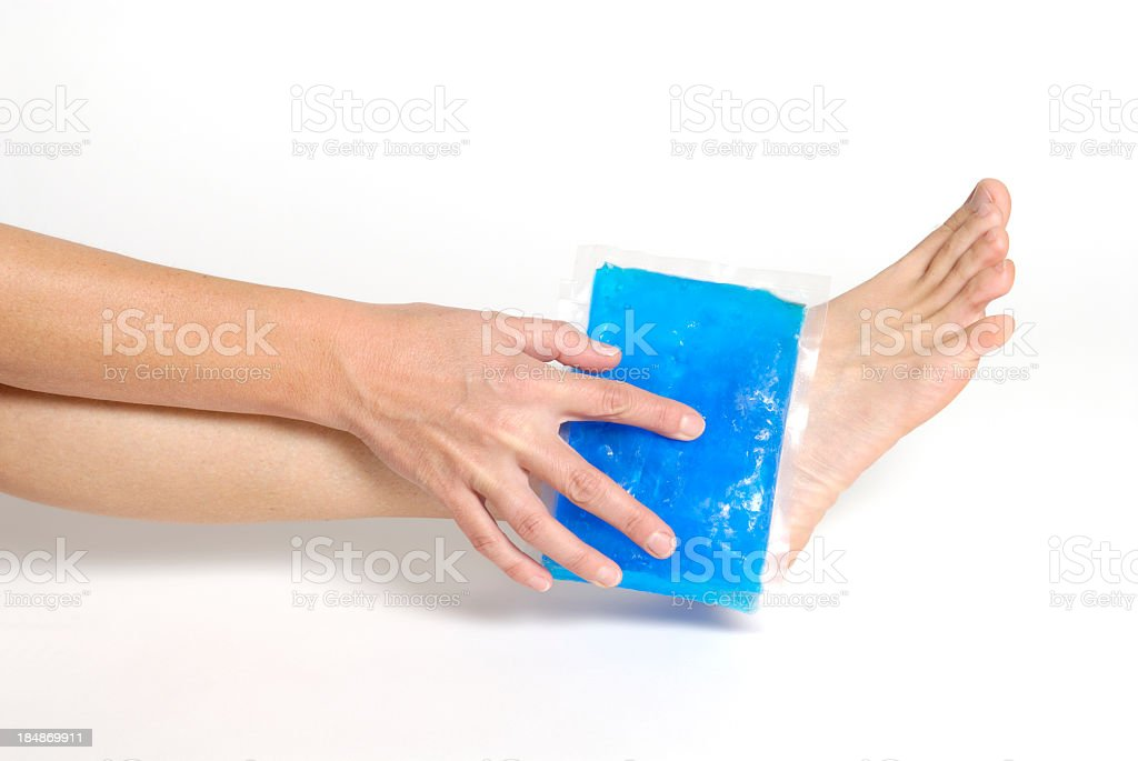 Blue gel pack applying on an ankle on white background stock photo