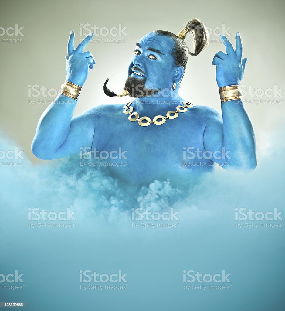 Blue genie came out of the lamp with smoke stock photo