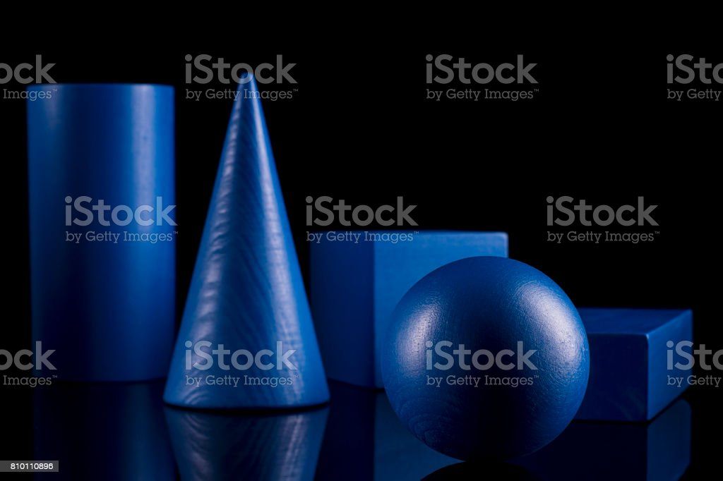 Blue geometric shapes on black background stock photo