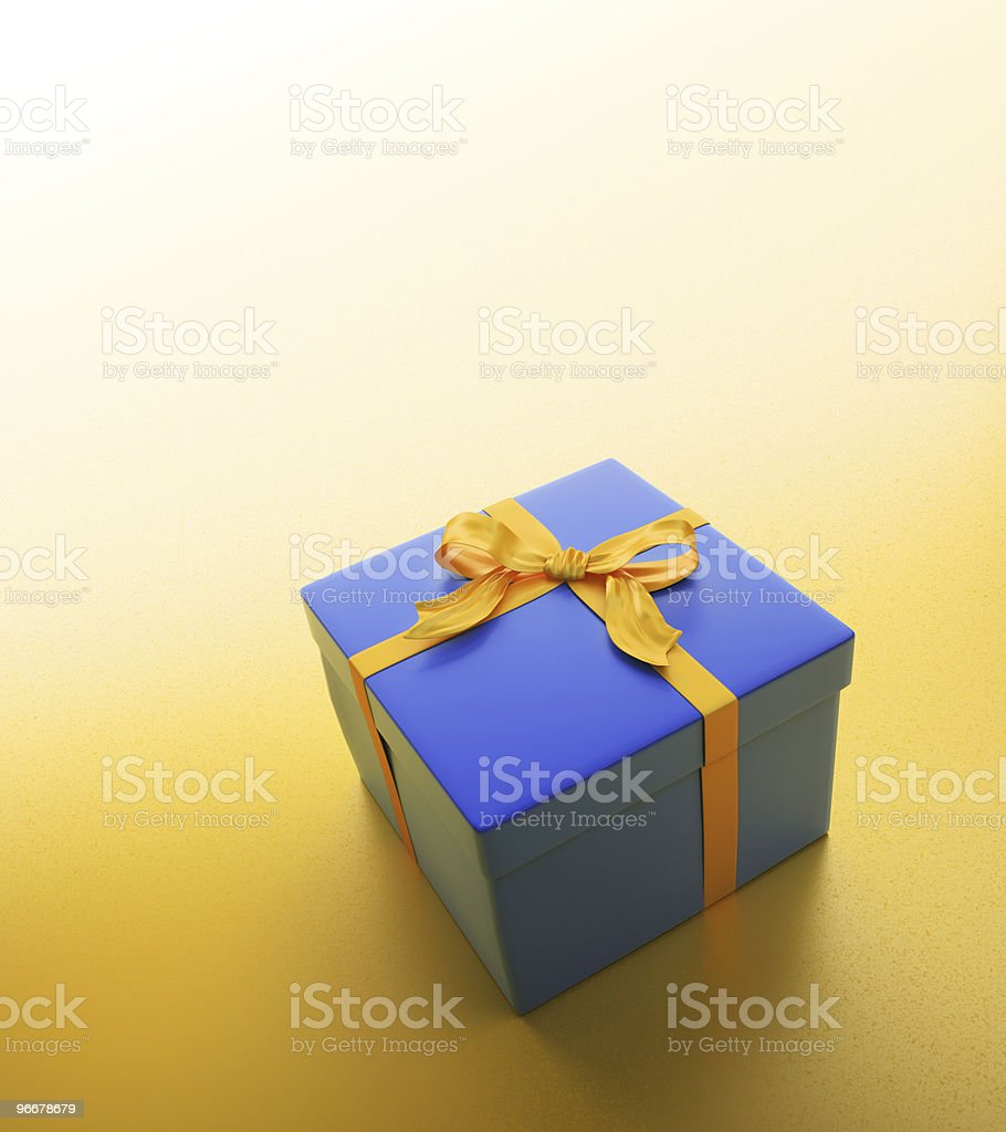 Blue gift with a golden ribbon stock photo