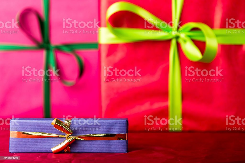 Blue gift with golden bowknot. stock photo