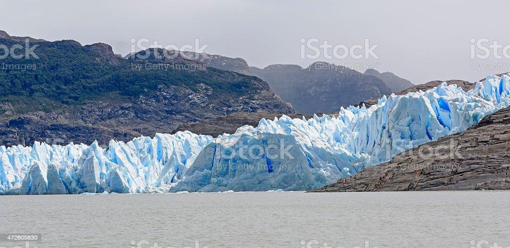 Blue Glacial Ice meeting a Glacial Lake stock photo