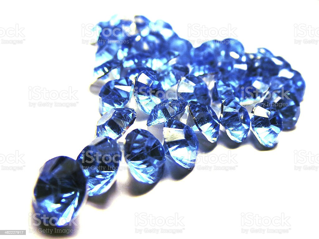 Blue glass crystals with silver back in shape of heart royalty-free stock photo