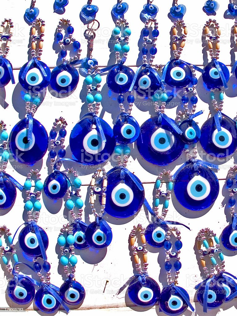 Blue glass evil eye charms royalty-free stock photo