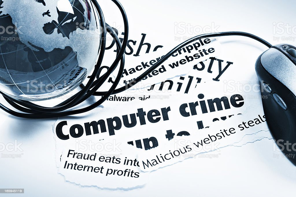 Blue glass globe paperweight, mouse on computer crime headlines royalty-free stock photo