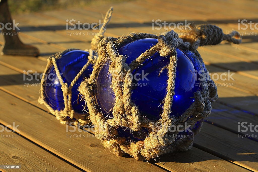 Blue glass spheres hit by afternoon sunlight royalty-free stock photo