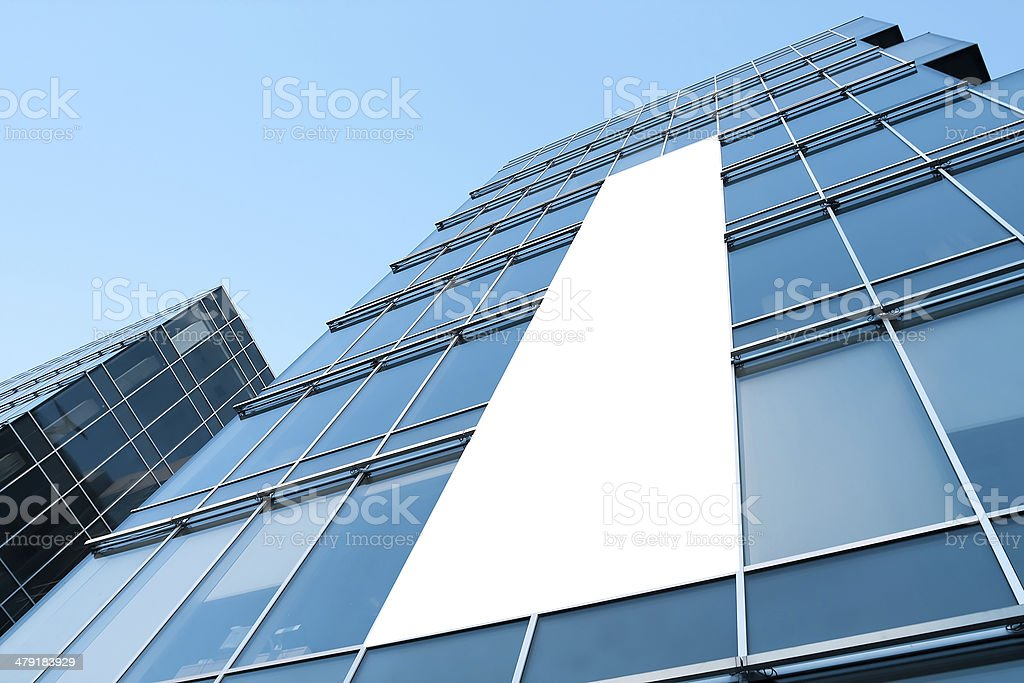 blue glass wall with blank placard of skyscraper stock photo