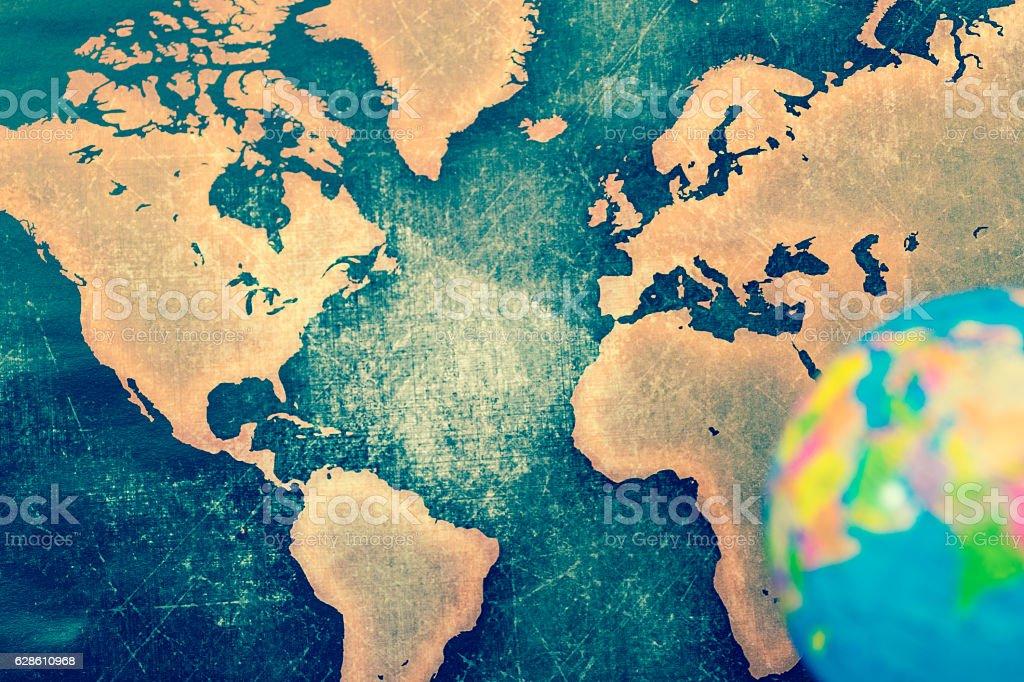 Blue globe against grunge world map stock photo
