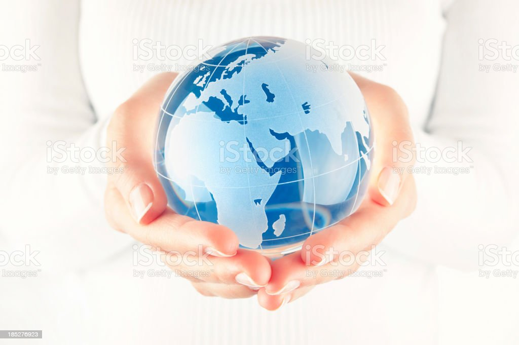 Blue globe in cupped hands royalty-free stock photo