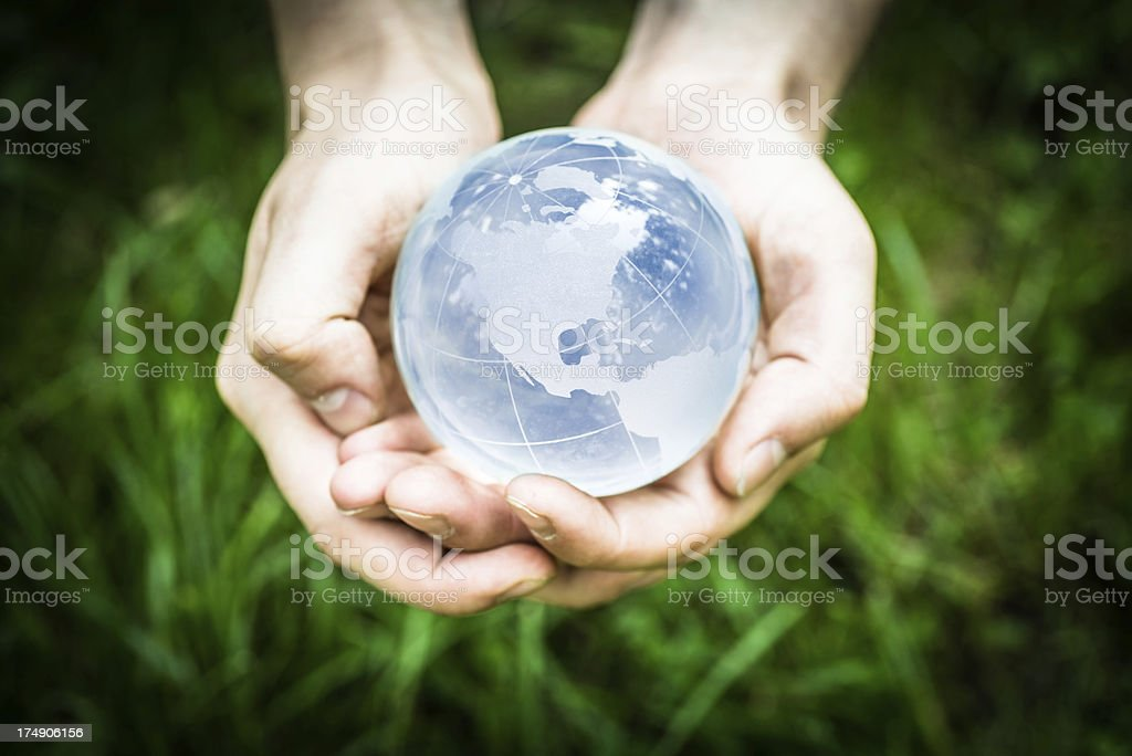 Blue globe in hands royalty-free stock photo