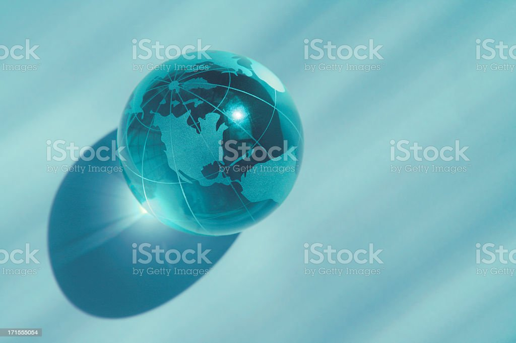 Blue globe marble with light shining through royalty-free stock photo
