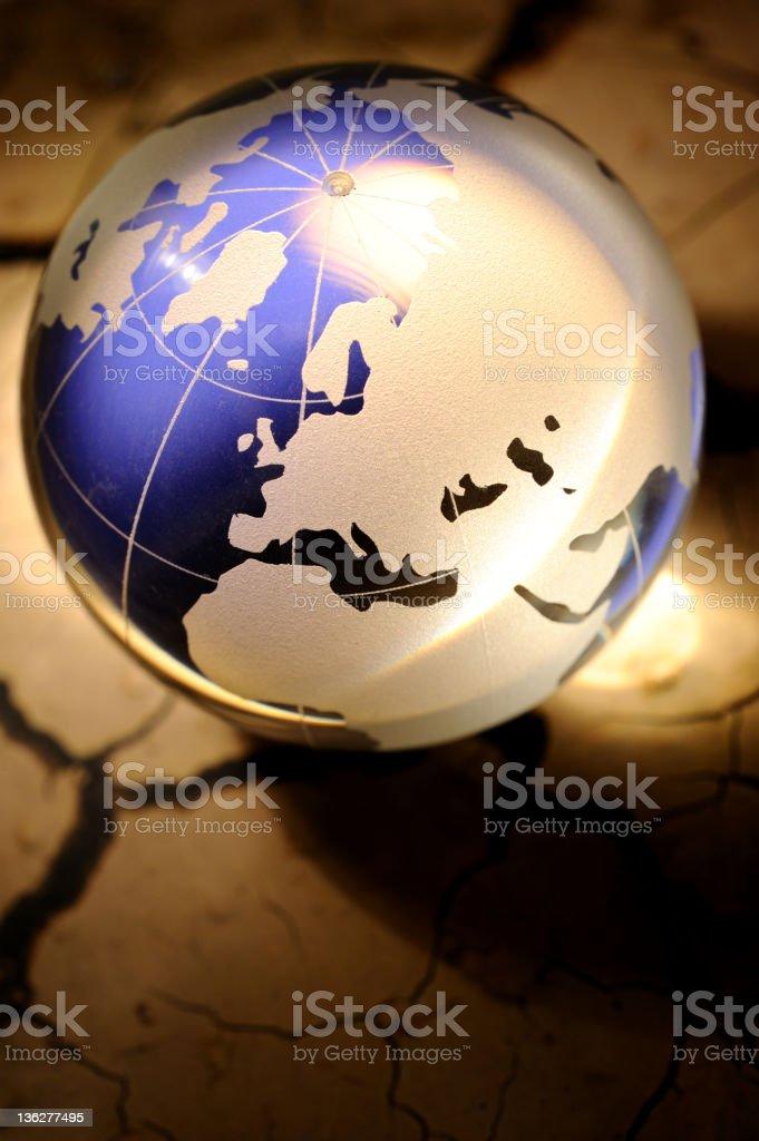 Blue globe on cracked dirt royalty-free stock photo