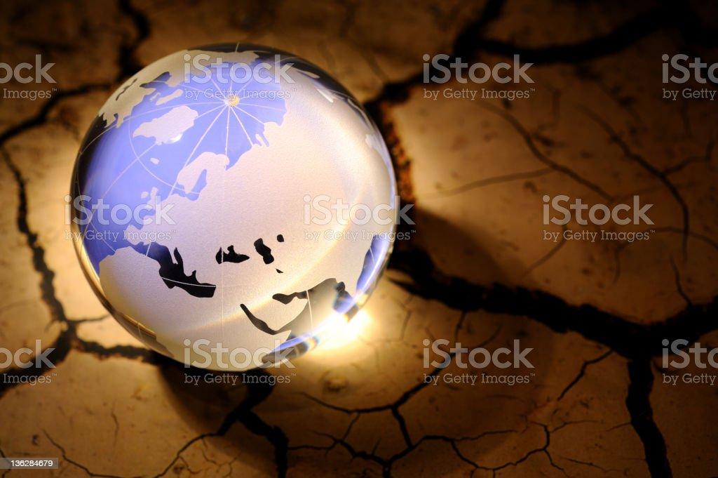 Blue globe on cracked dirt royalty-free stock photo