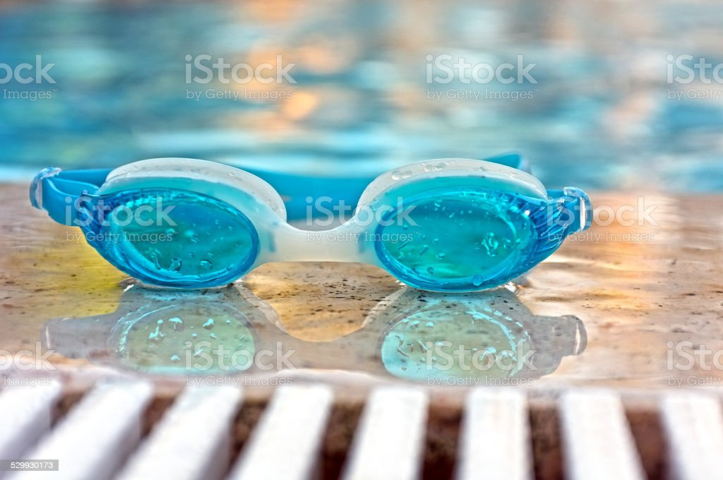 Blue goggles by the pool stock photo