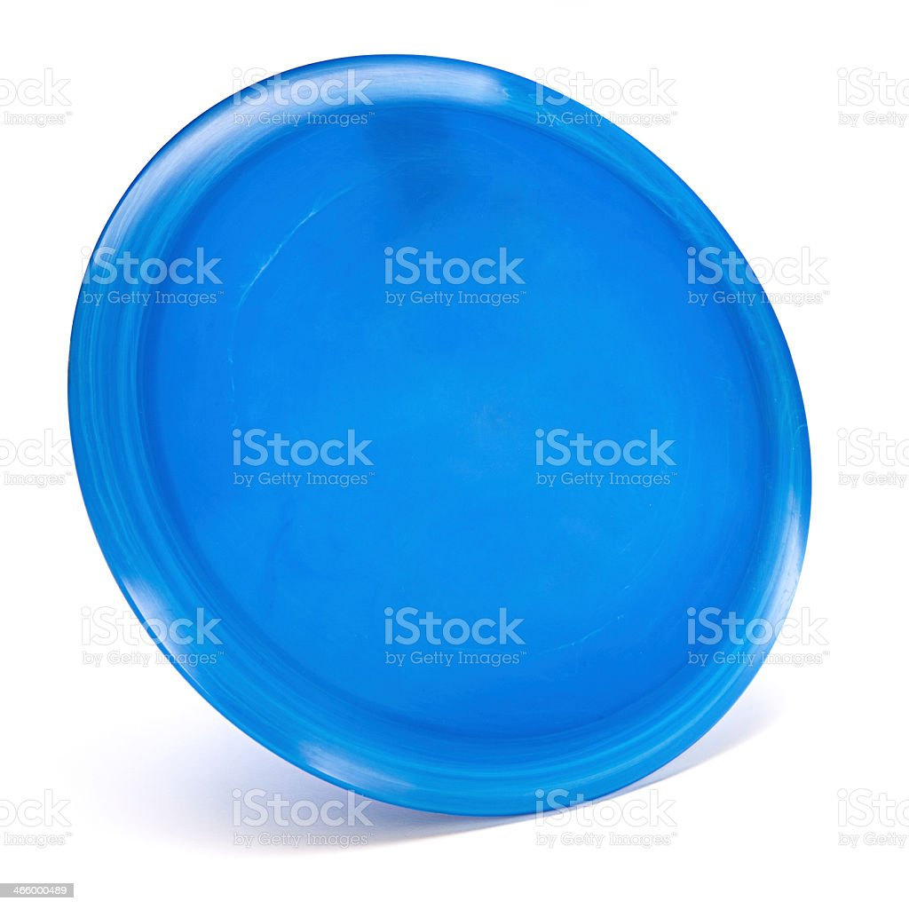 A blue golf disc on a white background stock photo