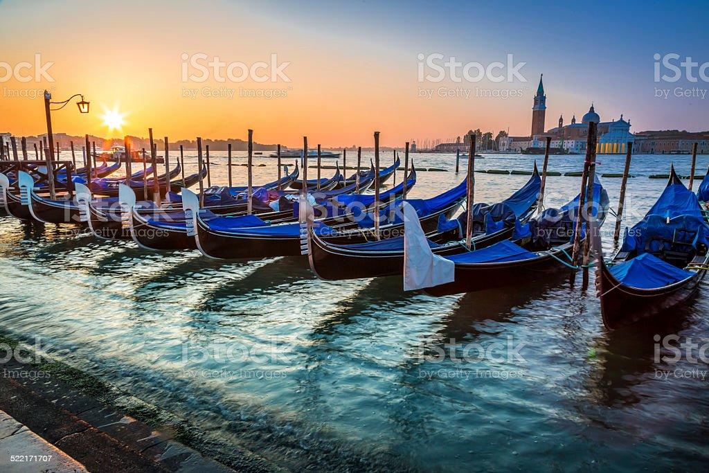 Blue gondolas at sunrise in Venice stock photo