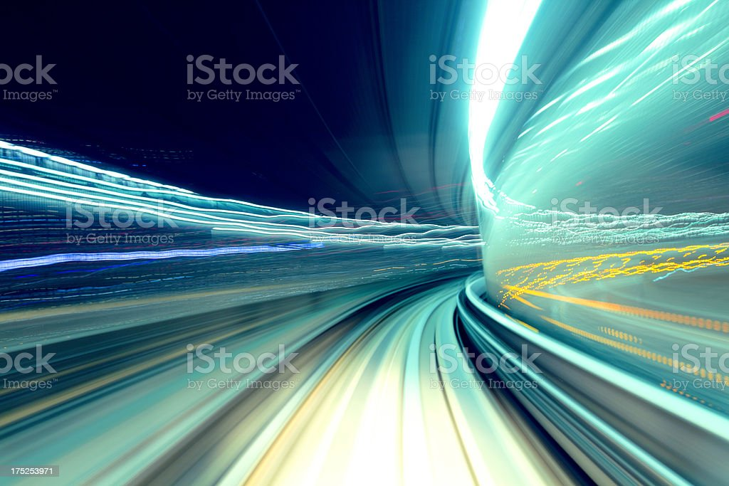 Blue, green and yellow-lit traveling night blur stock photo