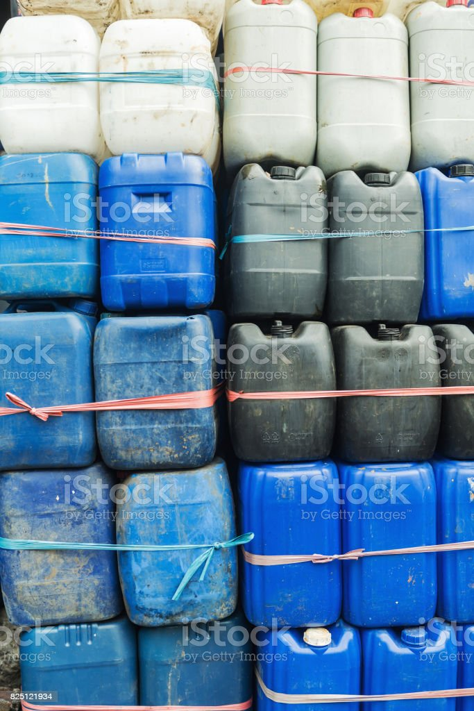 blue, grey and green oil barrels on a pile, Chemical Plant, Plastic Storage Drums, stock photo