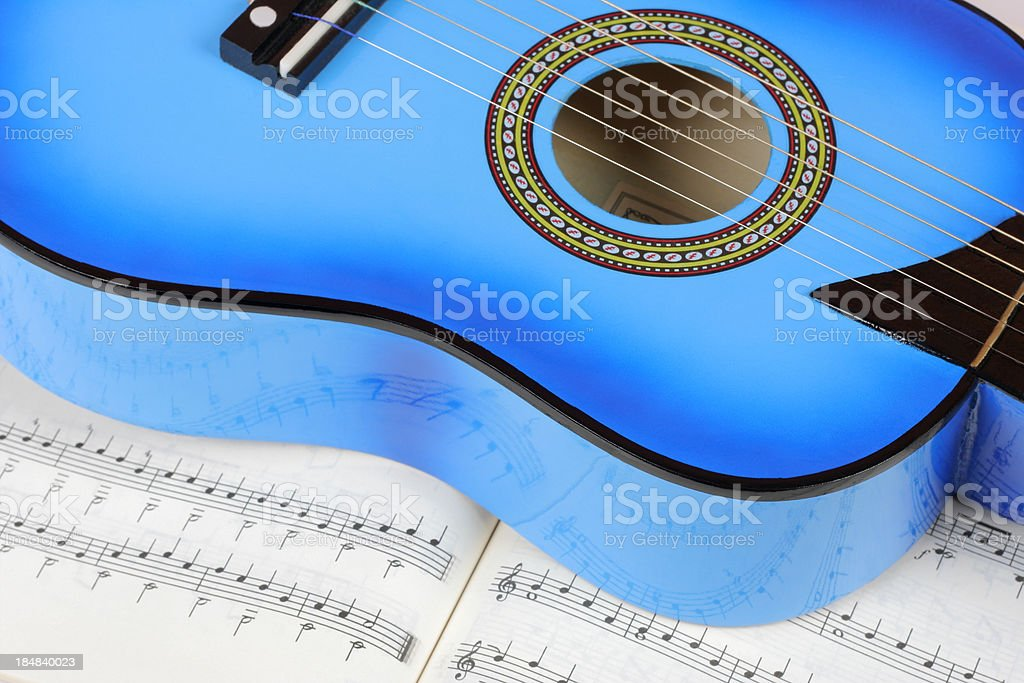 Blue guitar and tune royalty-free stock photo