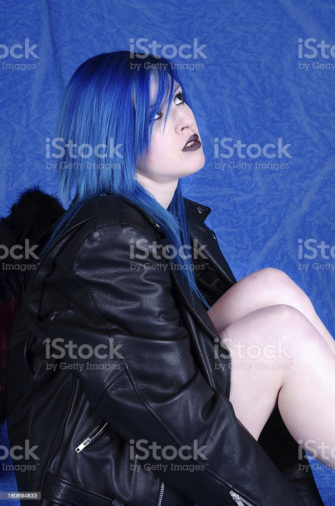 Blue haired fallen angel looking up royalty-free stock photo